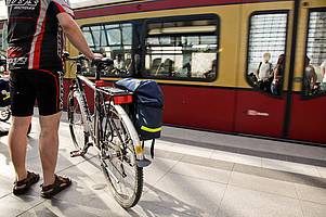 Young man on his bike at the station